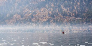 Kayaker on the Columbia River's Lake Pateros. Photo by Tyler Yates